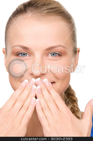 silence stock photo, bright picture of teenage girl with hands over mouth by Syda Productions