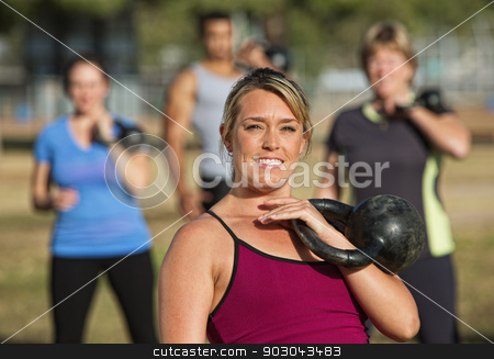 Close Up of Fitness Instructor stock photo, Close up of fitness instructor outdoors with students by Scott Griessel