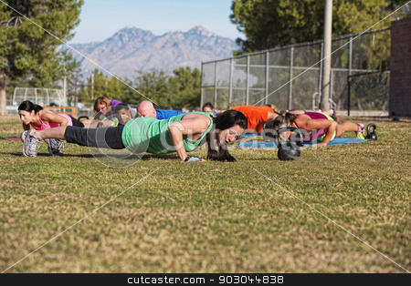 Push Ups Training Outdoors stock photo, Boot camp fitness group doing push up exercises outdoors by Scott Griessel