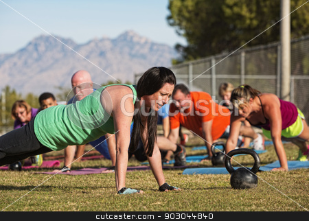 Doing Push Ups Near Mountains stock photo, Young woman leading group in push up exercises near mountains by Scott Griessel