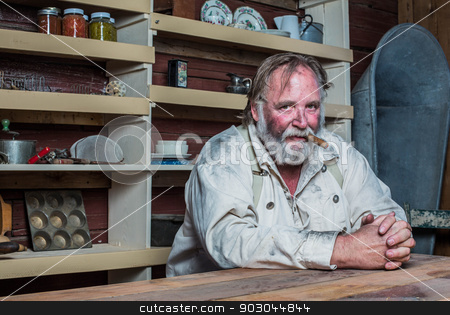 Smoking Western Man at Table stock photo, Smoking Western Man Looks Towards You as he Sits at Table by Scott Griessel