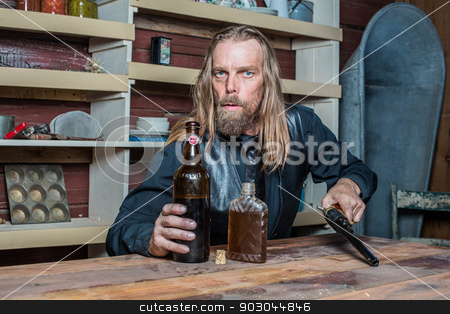 Drunk Western Man at Table stock photo, Drunk Western Man Looks Towards You as he Sits at Table by Scott Griessel