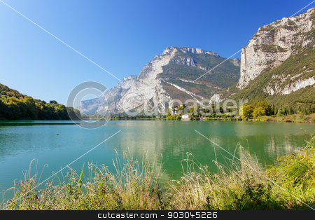 Toblino lake and castle stock photo, Castle Toblino near the lake with vivd water in Trentino region of Italy by Natalia Macheda