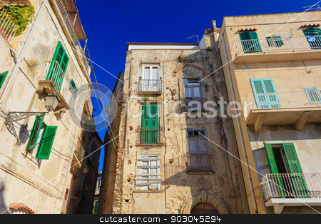 Tropea architecture stock photo, Tropea architecture with typical green shutters and yellow walls by Natalia Macheda