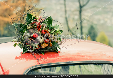 Autumnal bouquet on the top of retro car stock photo, Autumnal bouquet on the top of retro car. The noise is added for artistick purposes by Natalia Macheda
