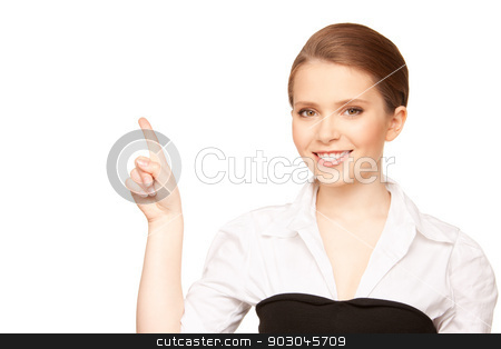 businesswoman pointing her finger stock photo, picture of attractive young businesswoman pointing her finger by Syda Productions