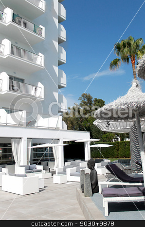 Luxurious modern hotel building stock photo, Exterior of luxurious modern hotel building with outdoor seating area. by Martin Crowdy
