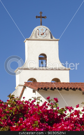 White Adobe Mission Santa Barbara Cross Bell Bougainvillea Calif stock photo, White Abobe Cross Steeple Bell Mission Red Bougainvillea Santa Barbara California.  Founded in 1786 at the end of Father Junipero Serra life. by William Perry