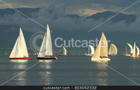 Sailboat race by sunset stock photo, Sailboat race on Geneva lake in front of Alps mountain by wonderful cloudy sunset by Elenarts