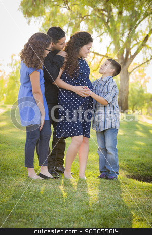 Happy Attractive Hispanic Family With Their Pregnant Mother Outd stock photo, Happy Attractive Hispanic Family With Their Pregnant Mother Outdoors At the Park. by Andy Dean