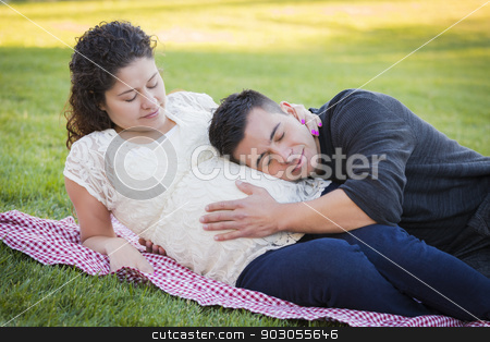 Pregnant Hispanic Couple in The Park Outdoors stock photo, Peaceful Pregnant Hispanic Couple in The Park Outdoors. by Andy Dean