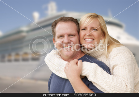 Young Happy Couple In Front of Cruise Ship stock photo, Young Happy Couple Hugging On The Dock In Front of a Cruise Ship. by Andy Dean