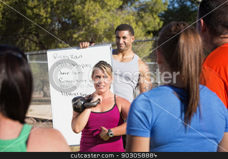 Woman Explaining Exericses to a Class stock photo, Boot camp fitness instructors explaining exercises to a class by Scott Griessel