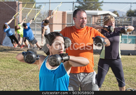 Men and Women in Boot Camp Fitness stock photo, Men and women in boot camp fitness class outdoors by Scott Griessel