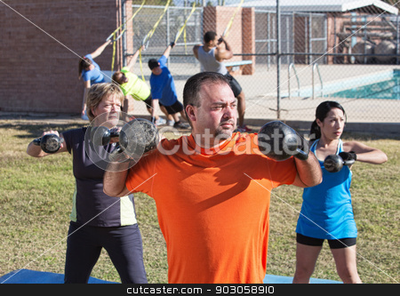 Three Adults Exercising Outdoors stock photo, Three mature adults exercising in outdoor boot camp by Scott Griessel
