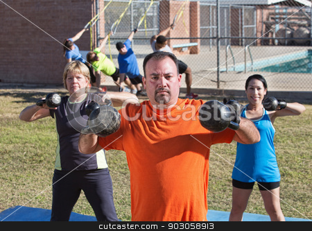 Adults Using Kettle Bell Weights stock photo, Three adults exercising shoulder muscles with kettle bell weights by Scott Griessel