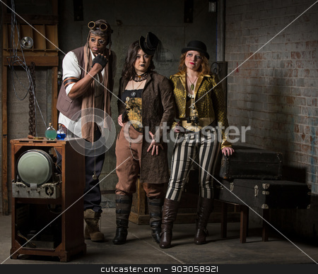 Steampunk Trio stock photo, Three Young Diverse Steampunks in Retro Lair by Scott Griessel