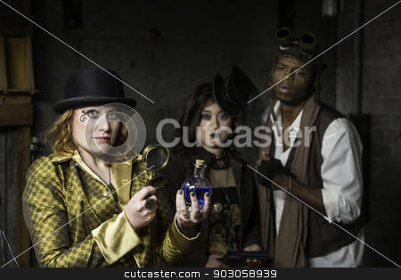 Steampunk with Magnifying Glass stock photo, Steam Punks in Underground Lair with Potion and Magnifying Glass by Scott Griessel