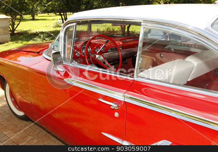 1960 Chevrolet Impala Bubble Top stock photo, RUSTENBURG, SOUTH AFRICA – FEBRUARY 15:  Red 1960 Chevrolet Impala Bubble Top Side View in Private Collection Philip Classic Cars on February 15, 2014 in Rustenburg South Africa.    by Snap2Art