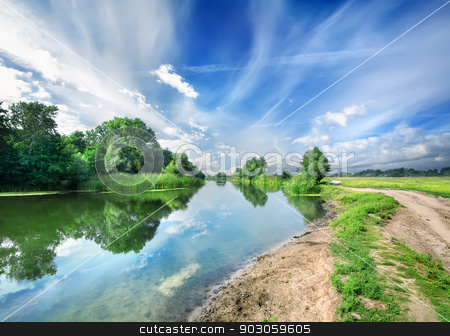 Silent blue river stock photo, Silent blue river near a country road by Givaga
