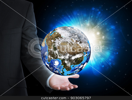 Man in suit holding a earth in hand stock photo, Man in suit holding a earth in hand. The concept of globalization by cherezoff