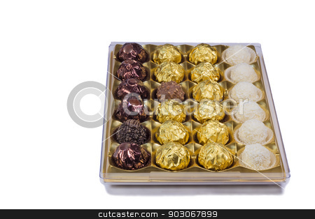 Chocolate sweets in the box on the white background. stock photo, A variety of chocolates in a box. Presented on a white background. by Georgina198
