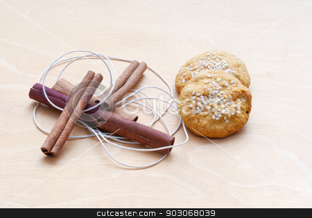 biscuits, cinnamon sticks and a cord stock photo, biscuits, cinnamon sticks and a cord by Sergiy Artsaba