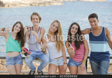 group of confident teens stock photo, group of confident teens with thumbs up and v signs by mandygodbehear