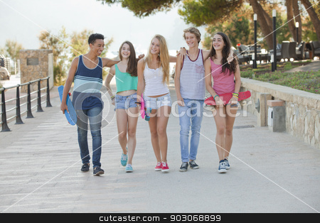 group of happy kids on vacation stock photo, group of happy diverse kids on summmer vacation by mandygodbehear
