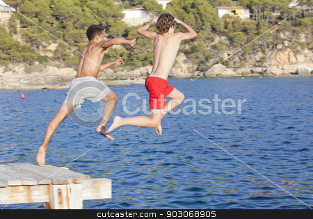 summer camp kids jumping in sea stock photo, summer camp kids jumping in sea by mandygodbehear