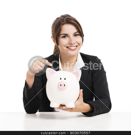 Businesswoman with a piggy bank stock photo, Beautiful hispanic business woman holding a piggy bank, isolated over white background by ikostudio
