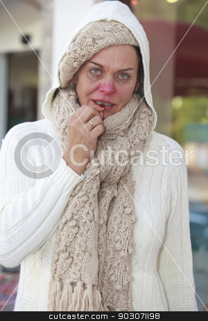 flu epidemic stock photo, Elderly woman with flu takes a cough drop by Roland Stollner