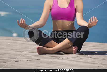 Yoga Exercises stock photo, Beautiful young woman in outdoor doing yoga by ikostudio
