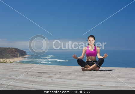 Yoga Exercises stock photo, Beautiful young woman in outdoor doing yoga by ikostudio