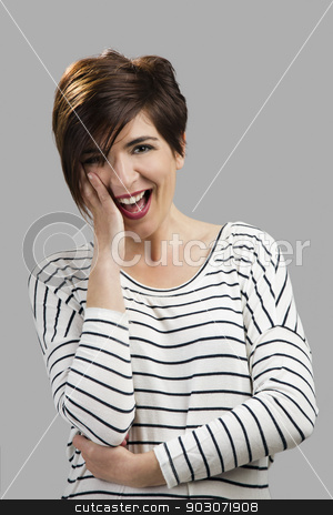 Young woman stock photo, Portrait of a beautiful woman smiling, over a gray background by ikostudio