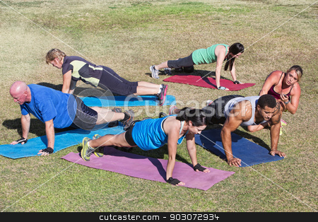 Diverse Group Exercising Outdoors stock photo, Diverse group of adults in boot camp fitness class by Scott Griessel