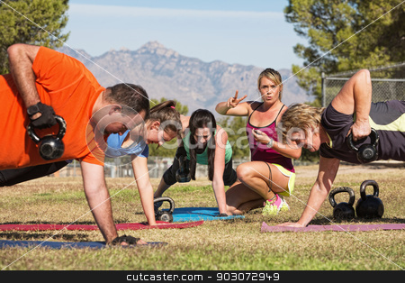 Fitness Instructor Teaching Mature Group stock photo, Female fitness instructor counting for exercise class by Scott Griessel