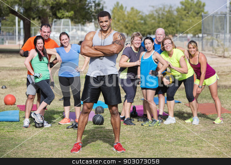 Confident Instructor with Fitness Class stock photo, Confident instructor with folded arms and fitness class by Scott Griessel