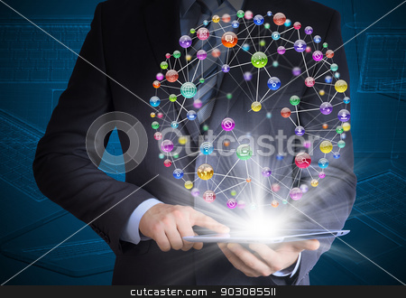Man in suit holding tablet pc stock photo, Man in suit holding tablet pc and application icons in hand. The concept of software by cherezoff