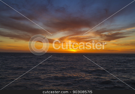 Glorious sunset stock photo, bright sunset over the calm pacific ocean by Yann Poirier