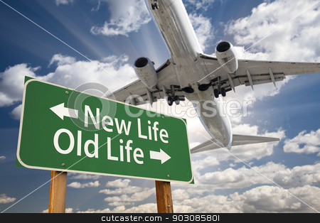 New Life, Old Life Green Road Sign and Airplane Above stock photo, New Life, Old Life Green Road Sign and Airplane Above with Dramatic Blue Sky and Clouds. by Andy Dean