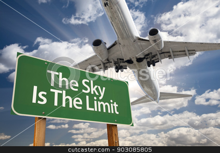 The Sky Is The Limit Green Road Sign and Airplane stock photo, The Sky Is The Limit Green Road Sign and Airplane Above with Dramatic Blue Sky and Clouds. by Andy Dean