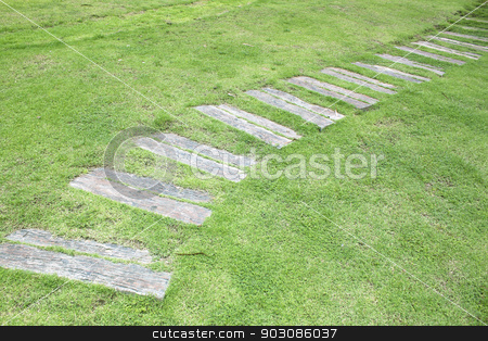 stone footpath stock photo, stone footpath garden grass green oblique lines. by janniwet