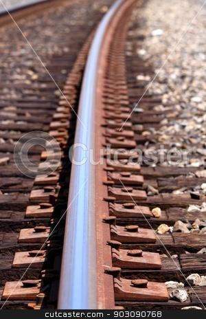 train track stock photo, close up shot of a train track by Henrik Lehnerer