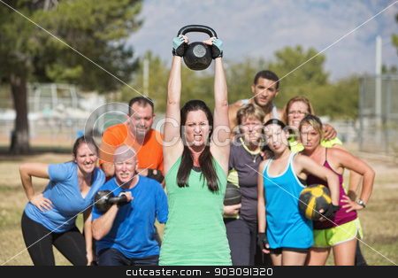 Woman Struggling with Weights stock photo, Young woman struggling with weighs in fitness class by Scott Griessel