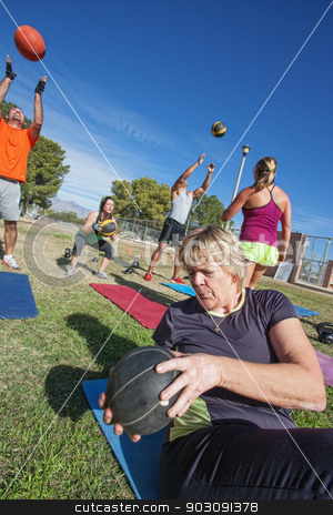 Diverse Group Exercising Outdoors stock photo, Diverse boot camp fitness class exercising outdoors by Scott Griessel