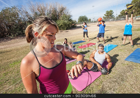 Fitness Trainer Checking Time stock photo, Boot camp fitness trainer checking group with stopwatch by Scott Griessel