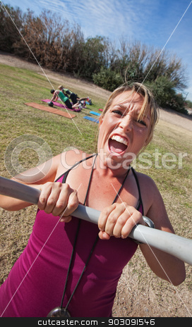 Yelling Fitness Instructor stock photo, Loud boot camp fitness instructor with outdoor class by Scott Griessel