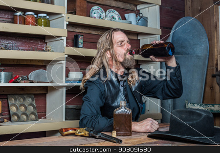 Drunk Western Man at Table stock photo, Drunk Western Man Looks Towards His Drink as he Sits at Table by Scott Griessel