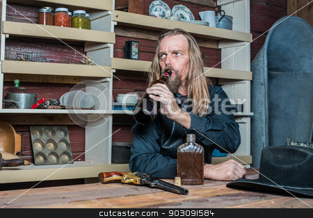 Drunk Western Man at Table stock photo, Drunk Western Man Looks Into the Distance as he Sits at Table by Scott Griessel